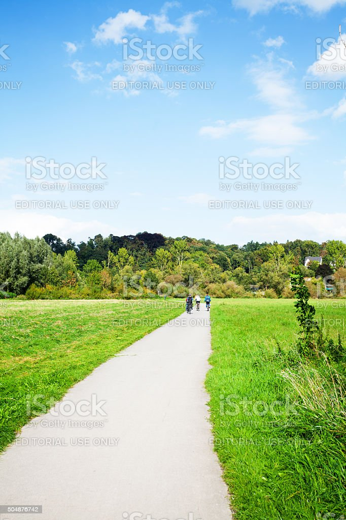 People on pathway close to river Ruhr stock photo
