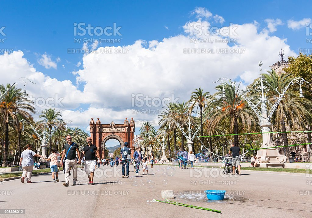People on promenade by Arch of Triumph Barcelona, Spain stock photo
