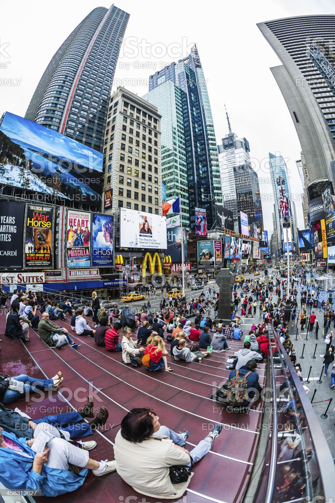 People on red steps at Times Square, New York City royalty-free stock photo