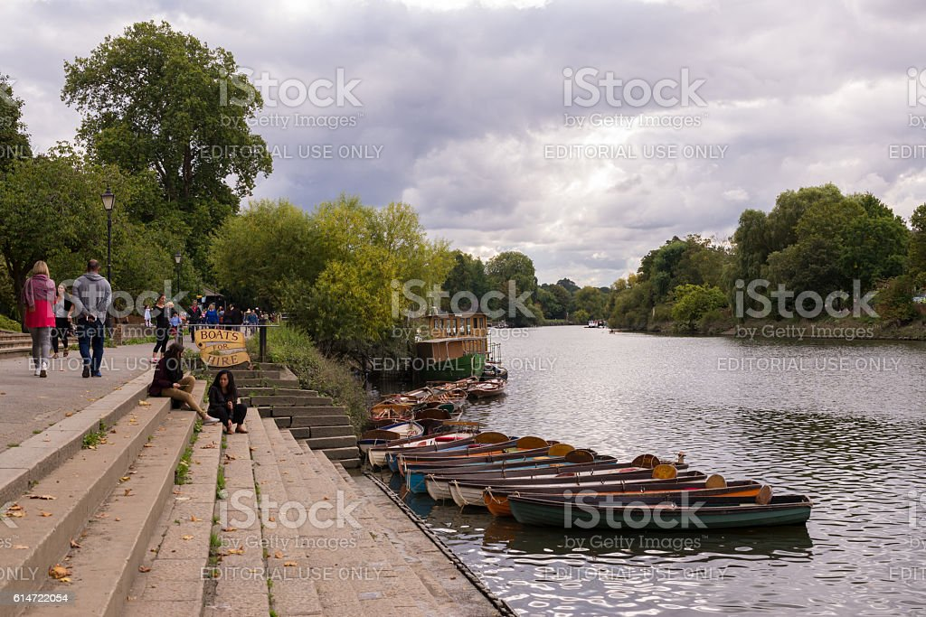People on Richmond riverfront next to river Thames stock photo