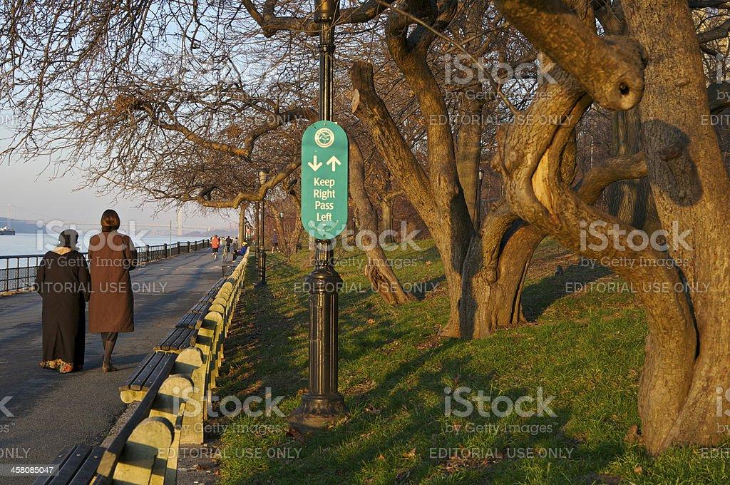 People on Riverside Park Promenade at sunset, New York City stock photo