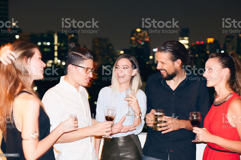 People on rooftop party. stock photo