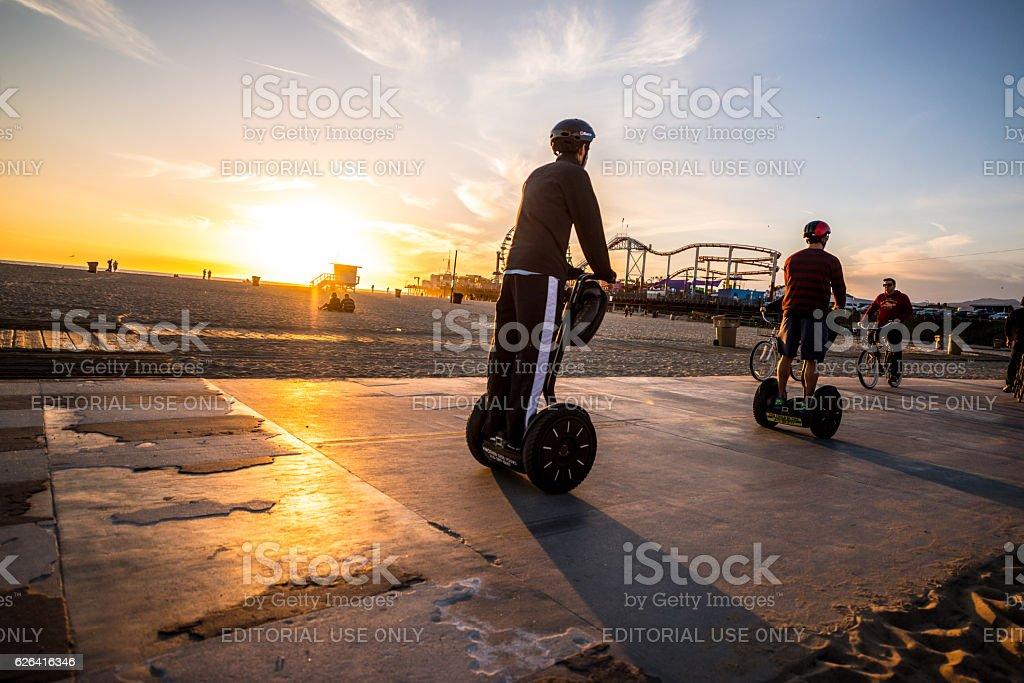 People on Segway, Santa Monica Beach, CA, USA stock photo