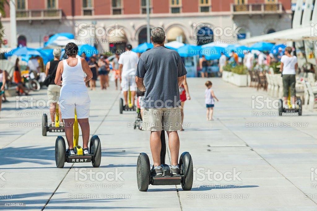 People on Segways in Split waterfront stock photo