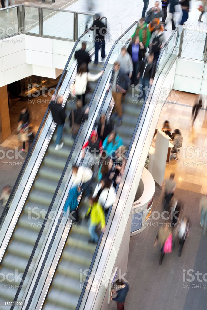People on shopping centre escalator royalty-free stock photo