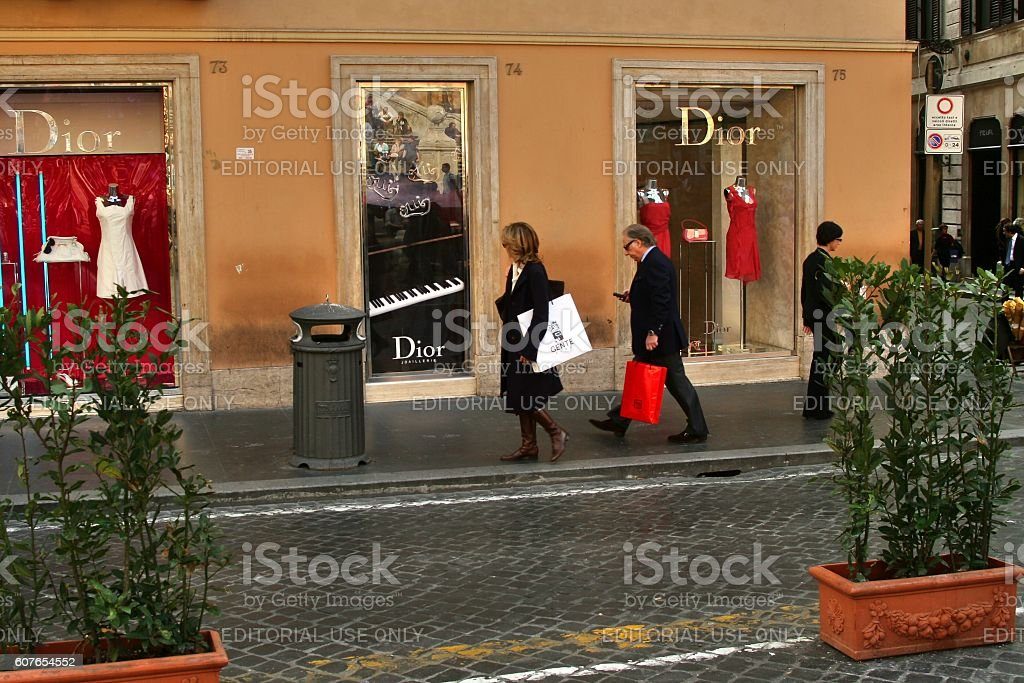 people on shopping tour in front dior store, rome, italy stock photo
