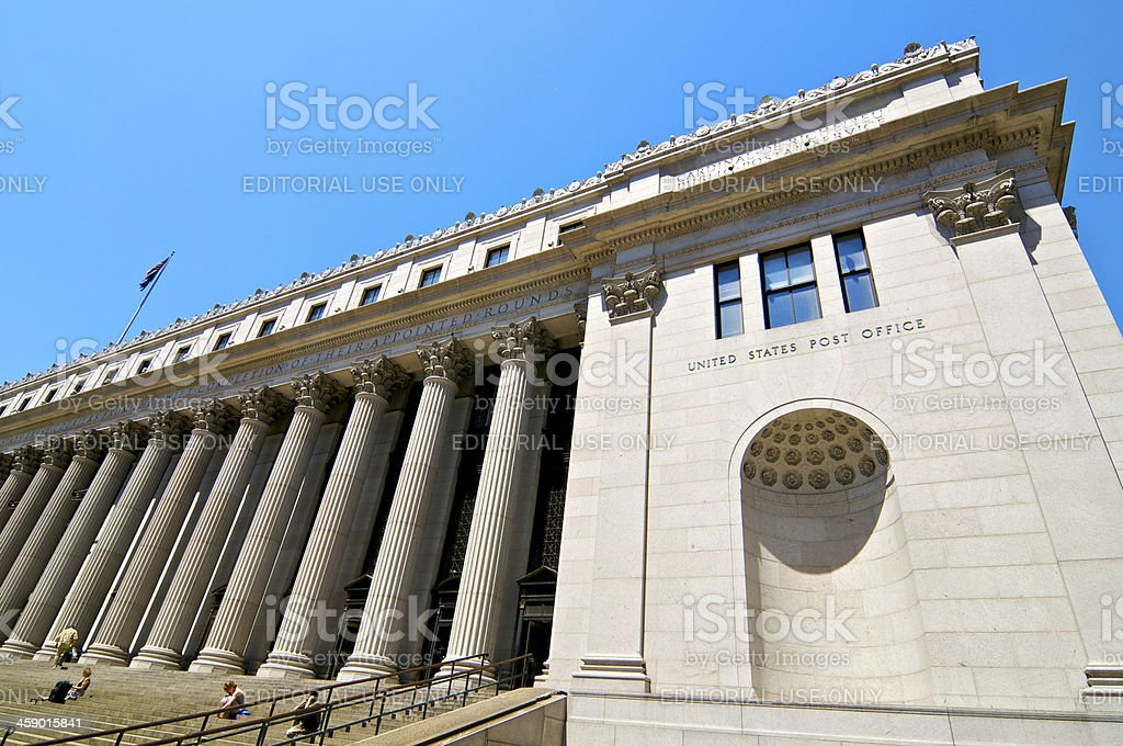 People on steps of Farley Post Office Building, NYC stock photo