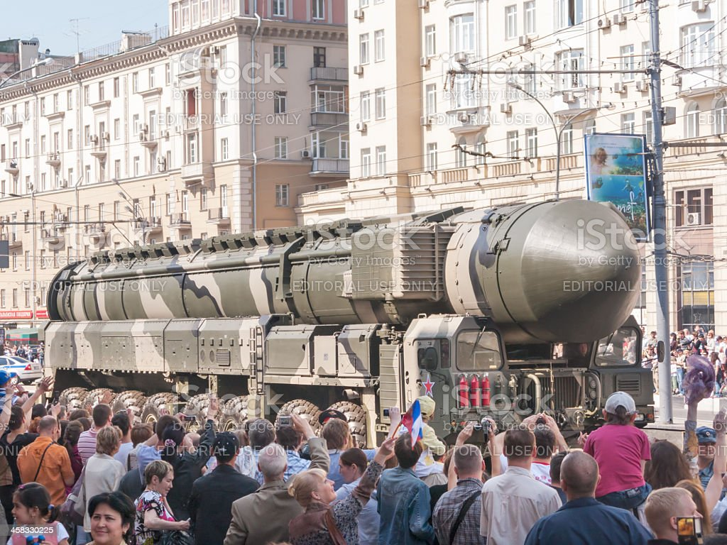 People on street side look at Topol-M intercontinental ballistic missile stock photo