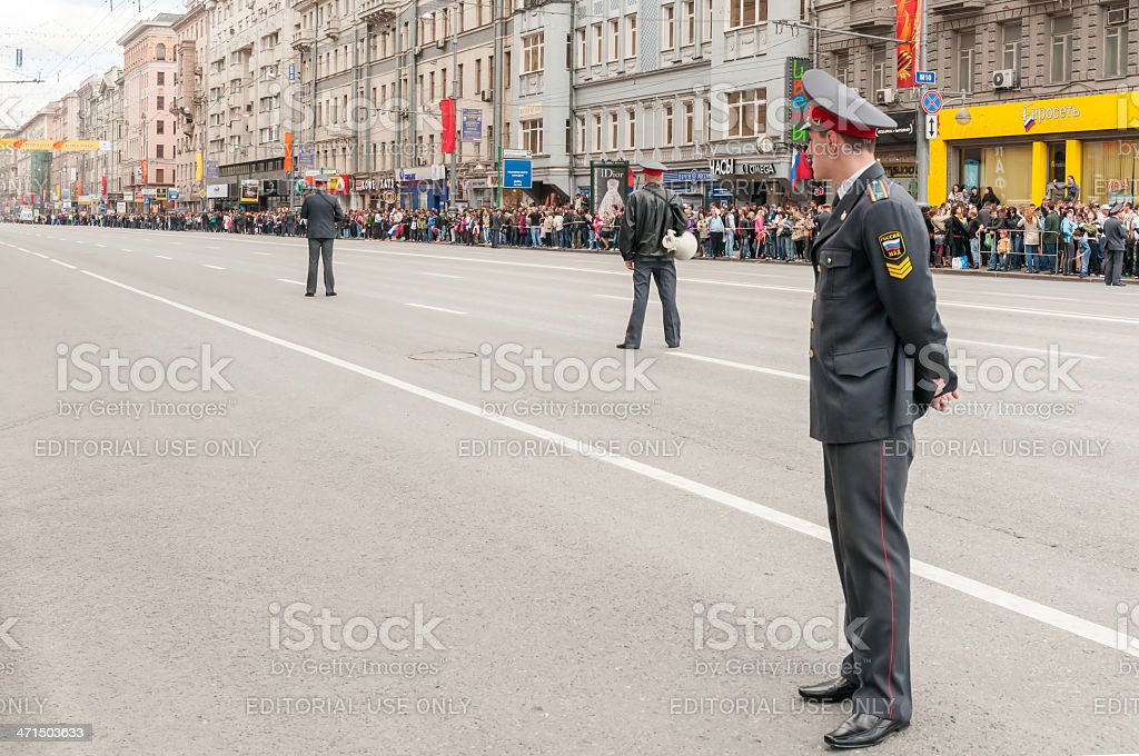 People on street wait for motorcade of parade festivities royalty-free stock photo