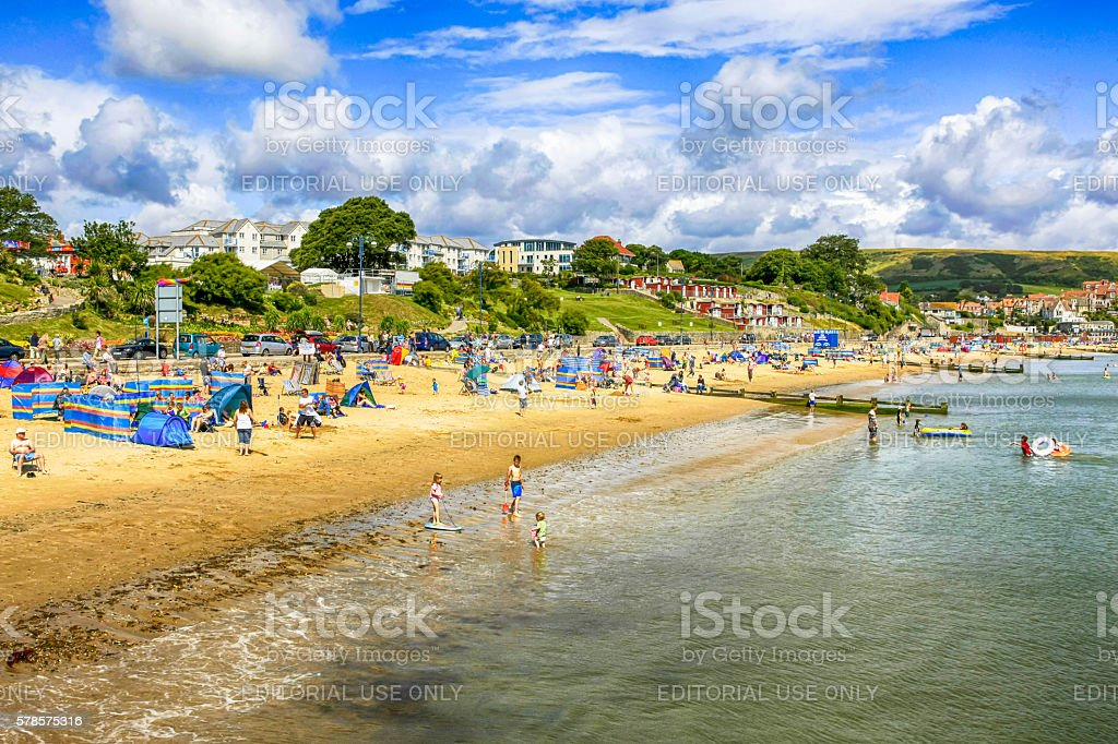 People on the beach at Swanage, UK stock photo