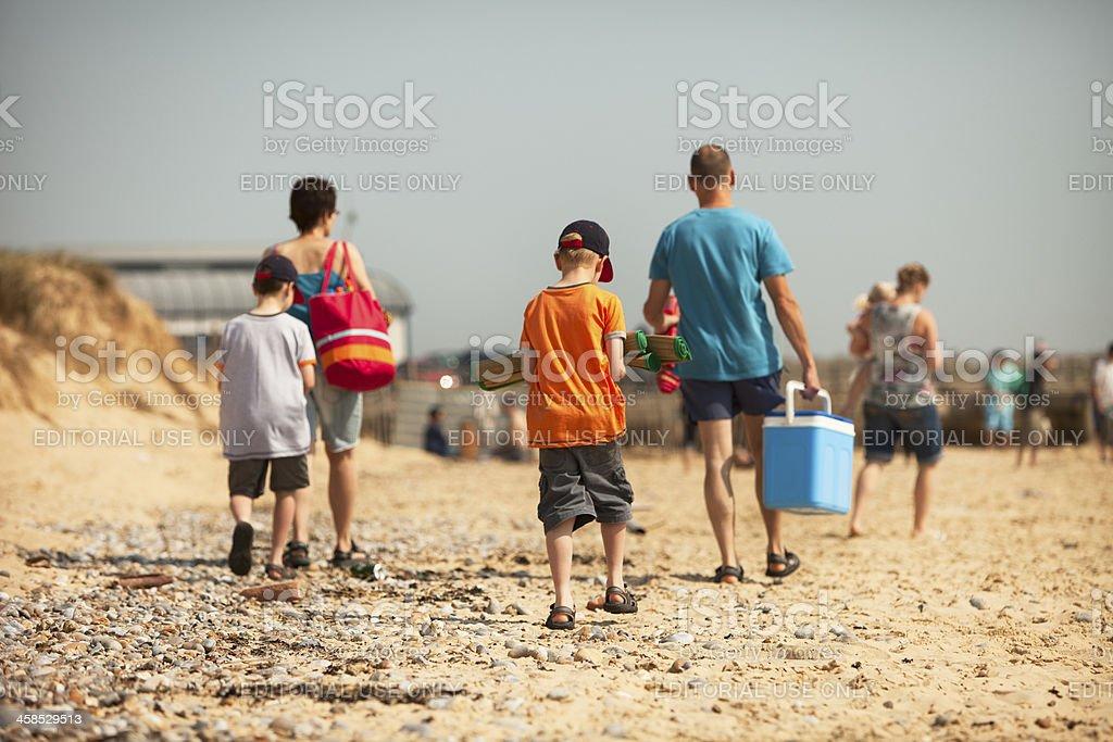 people on the beach at Walberswick in suffolk stock photo