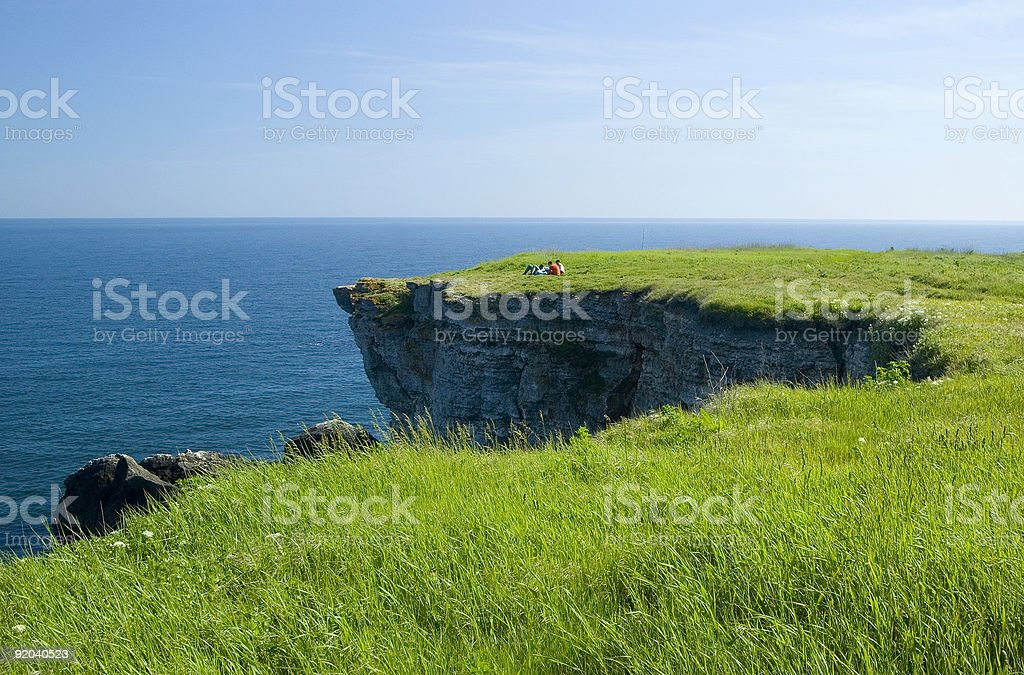 People on the Black Sea shore rocks royalty-free stock photo