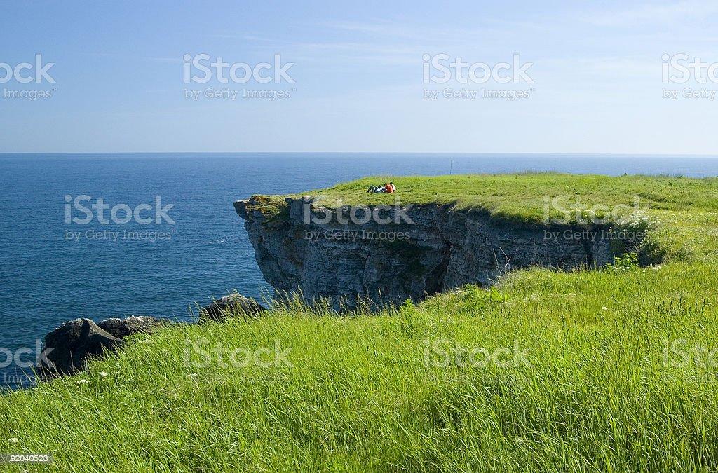 People on the Black Sea shore rocks stock photo