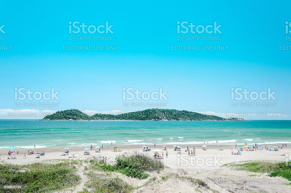 People on the Campeche beach with a green water stock photo