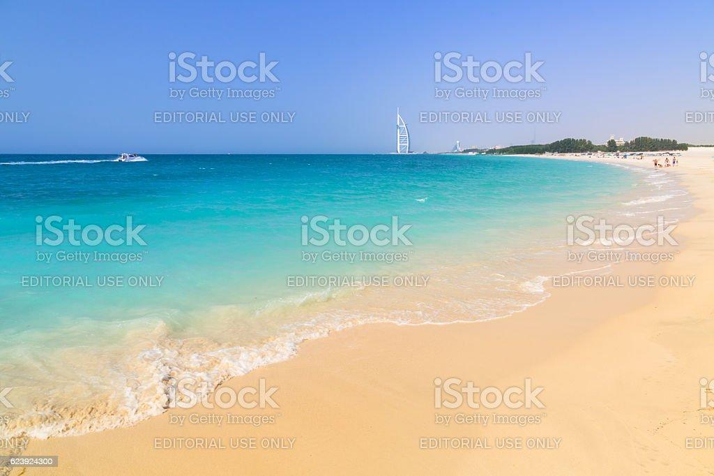 People on the Jumeirah Beach in Dubai, UAE. stock photo