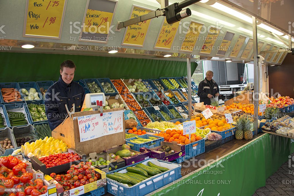people on the market with fruit stall royalty-free stock photo