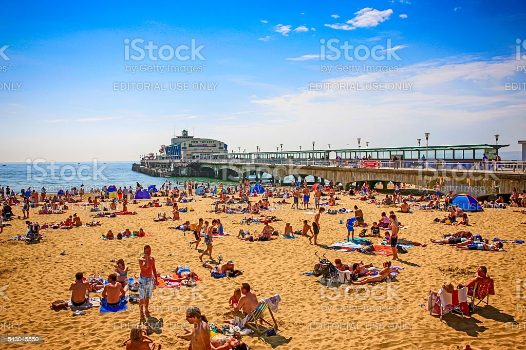People on the pier and beach at Bournemouth, UK stock photo