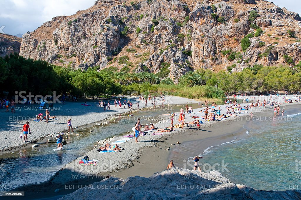 People on the Preveli Beach on Crete, Greece. stock photo