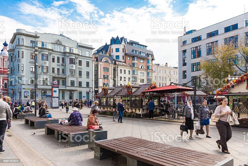 People on the square near Tretyakovskaya metro station stock photo