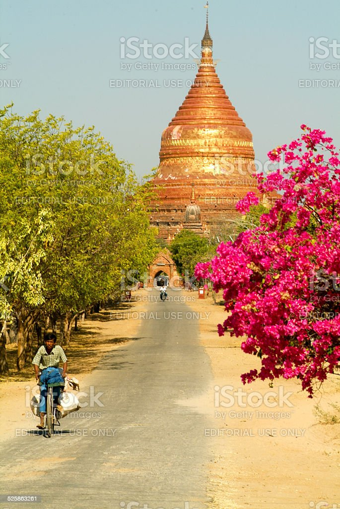 People on the street in front of Dhammayazika pagoda stock photo