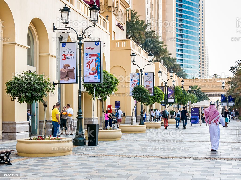 People on The Walk Promenade in Dubai Marina stock photo