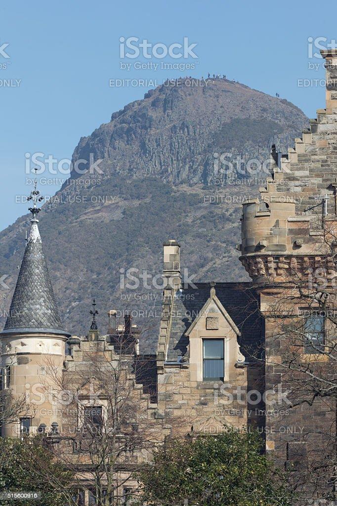 People on top pf Arthur's seat in Edinburgh's Holyrood PArk stock photo
