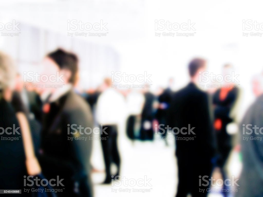 people on trade fair convention - blurred stock photo