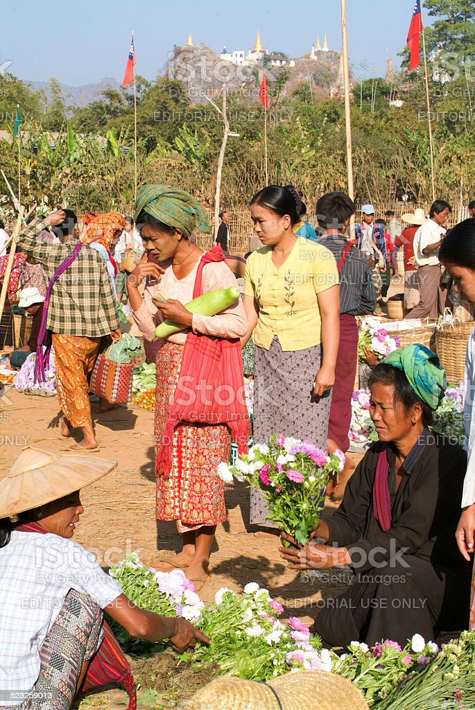 people on traditional clothes at the weekly market at Indein stock photo
