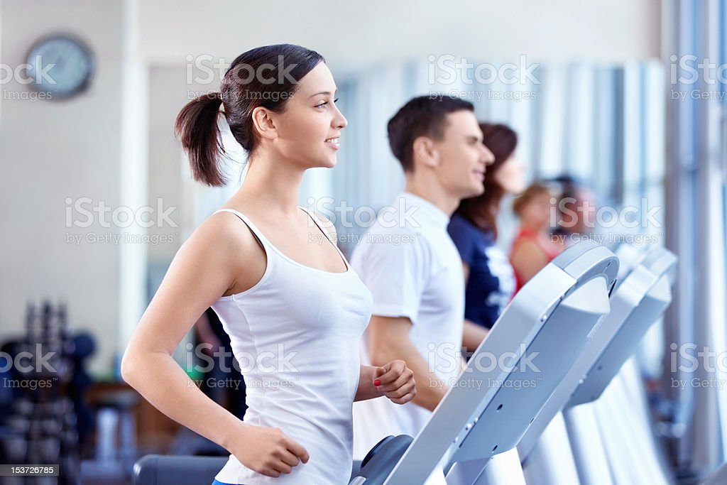People on treadmills stock photo