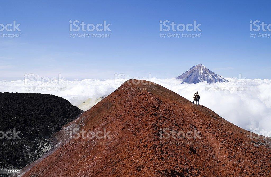 people on volcano stock photo
