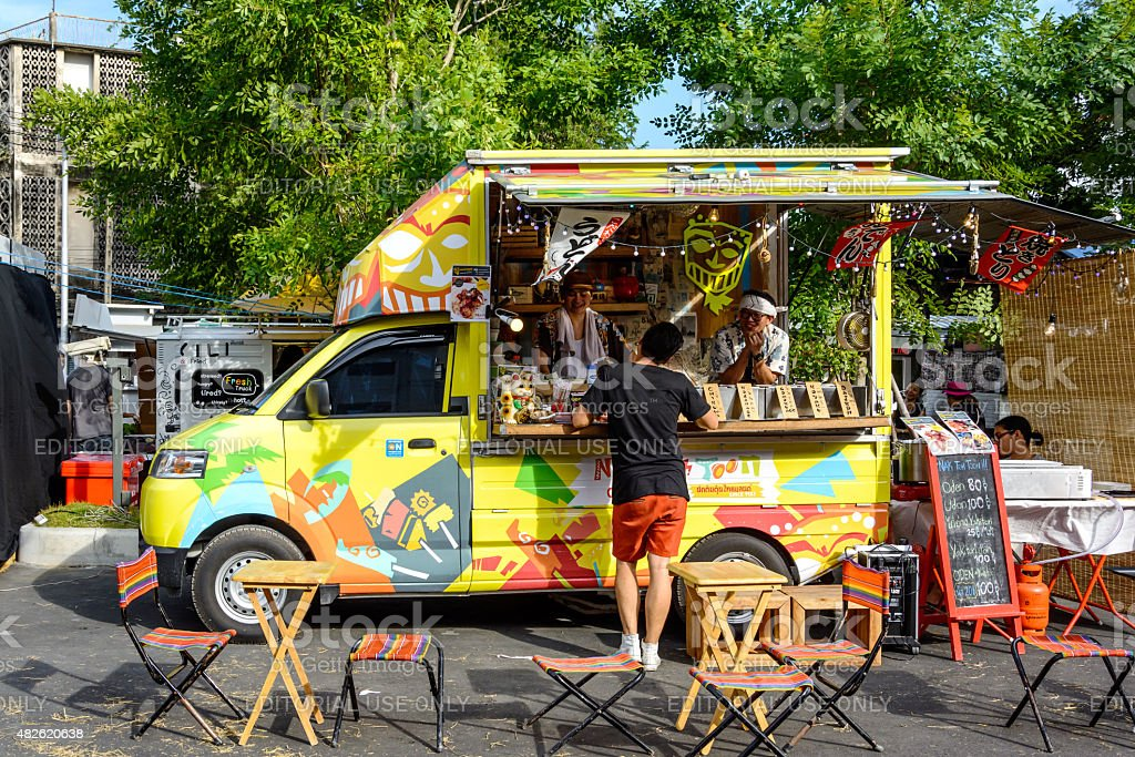 People order meal from food trucks at Food Truck Fair stock photo