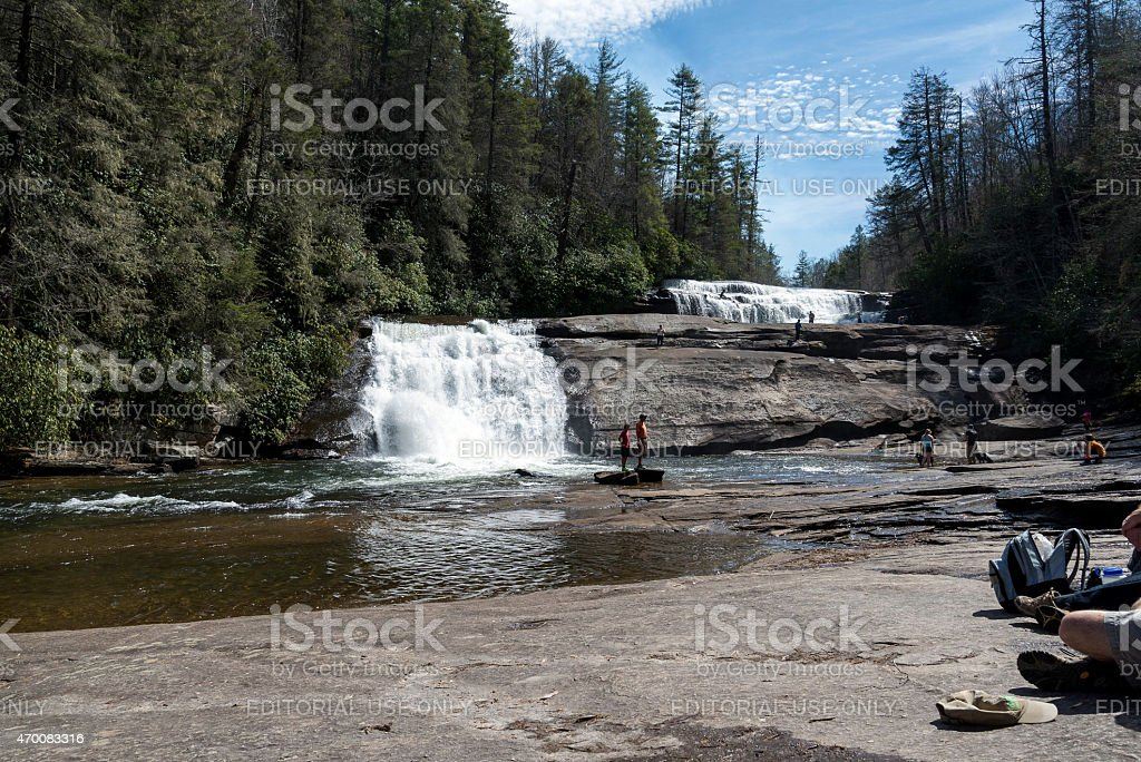 People outdoors at waterfalls stock photo