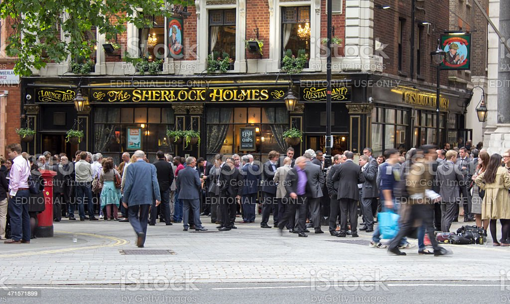 People outside a pub socialising royalty-free stock photo