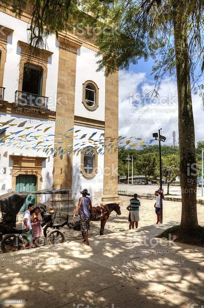 People outside old Brazilian colonial building royalty-free stock photo