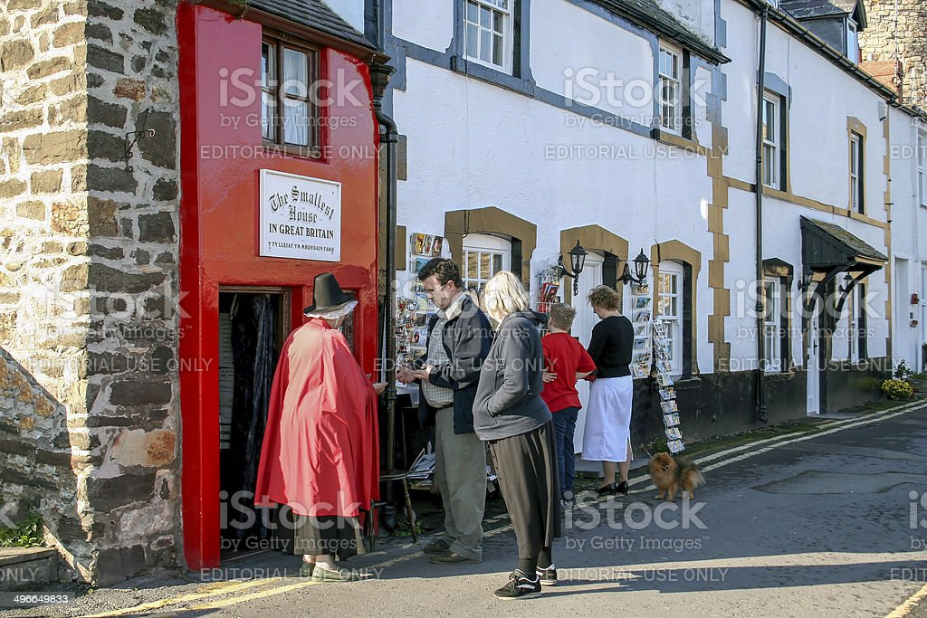 People Outside Smallest House Conwy stock photo