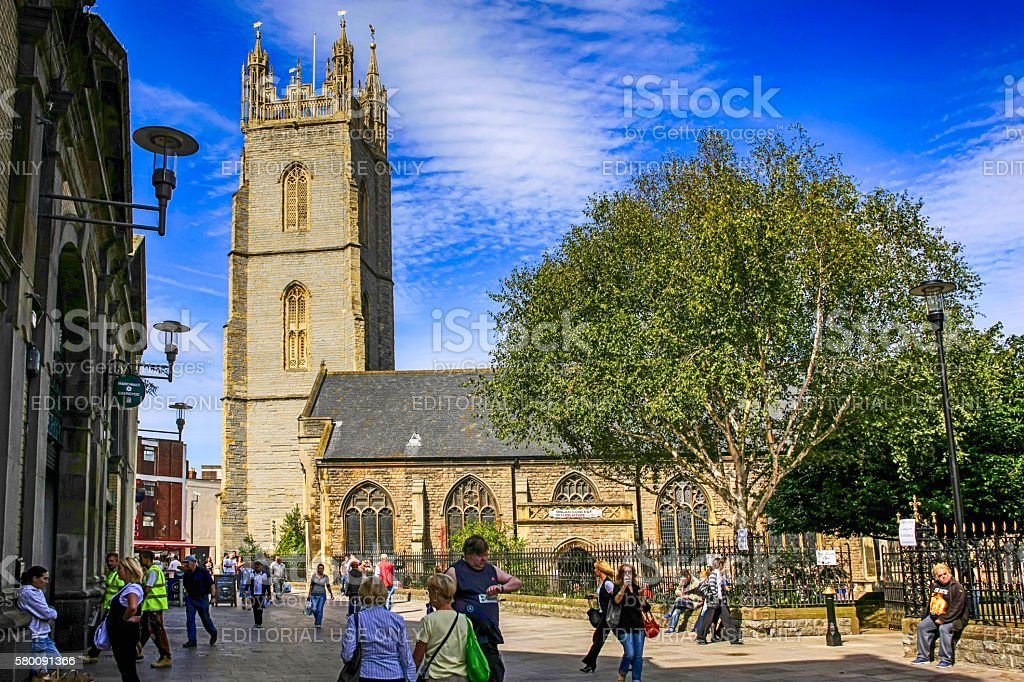People outside St. John's Church in Cardiff City center, UK stock photo