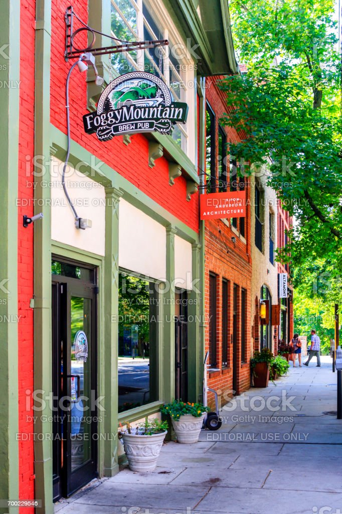 People outside the Foggy Montain Brew Pub situated in downtown Asheville, NC, USA stock photo