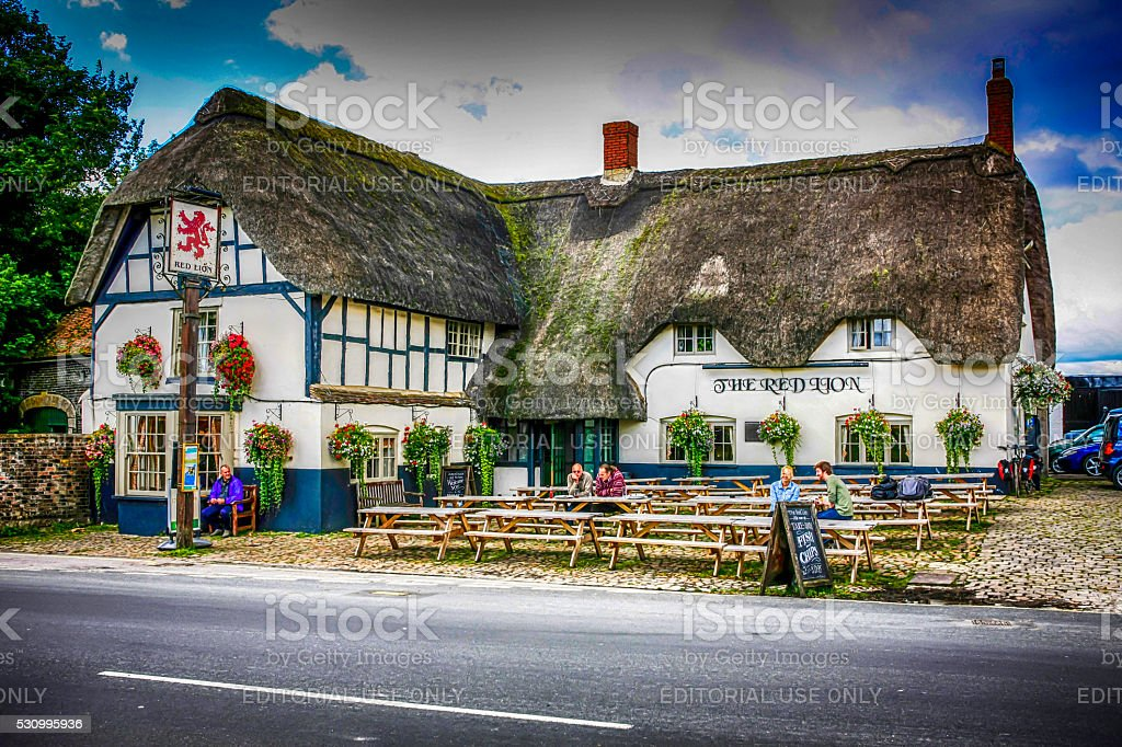 People outside the Red Lion pub in Avebury Wiltshire, England stock photo