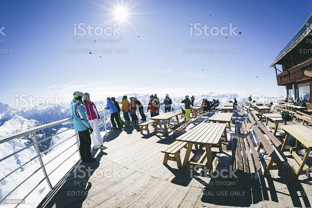 People overlooking the Alps royalty-free stock photo