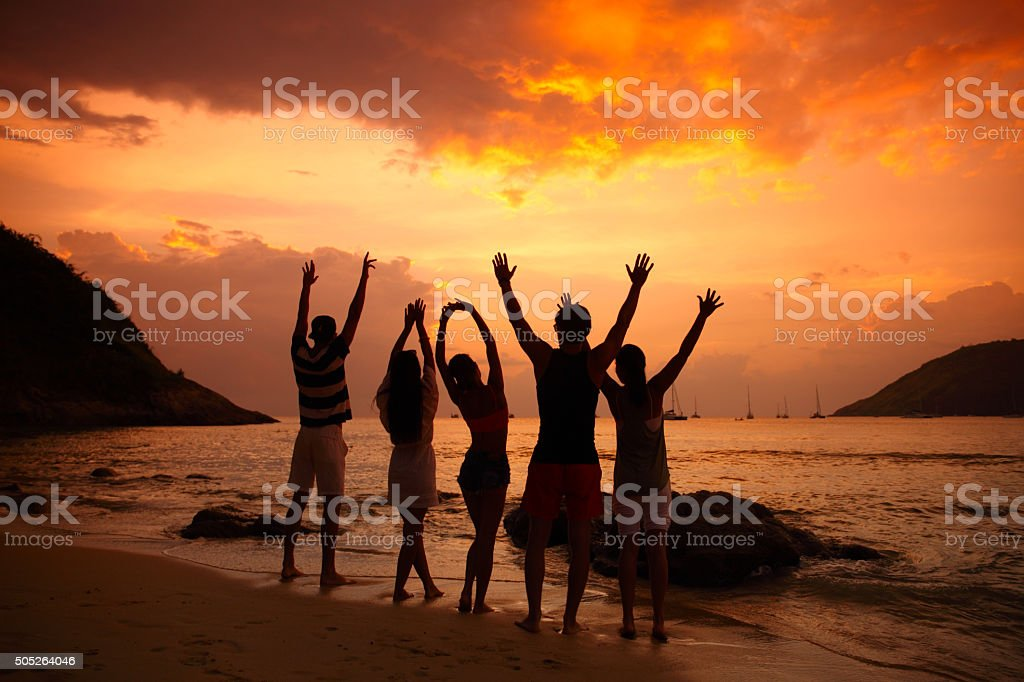 People partying on beach stock photo