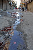 People pass along stream with blood after Ramadan, Cairo, Egypt.