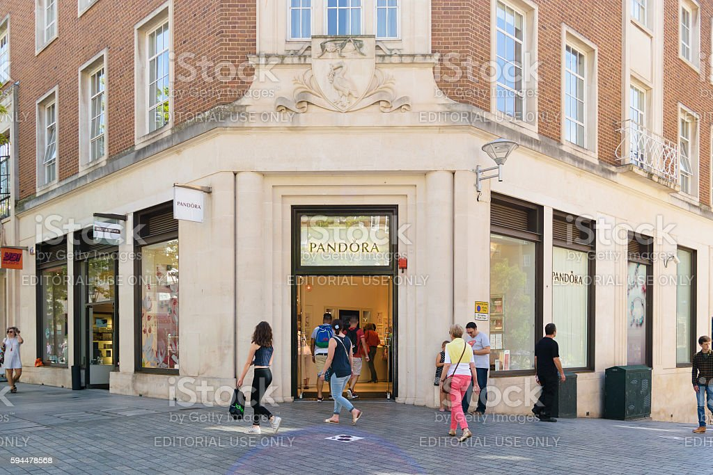 People pass by Pandora store stock photo