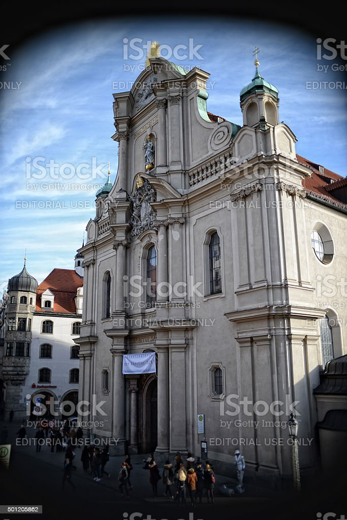 people passing by Heiliggeistkirche (Munich) stock photo