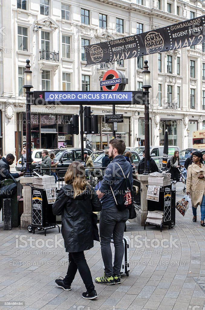 People passing by the entrance of Oxford Circus Subway Station stock photo