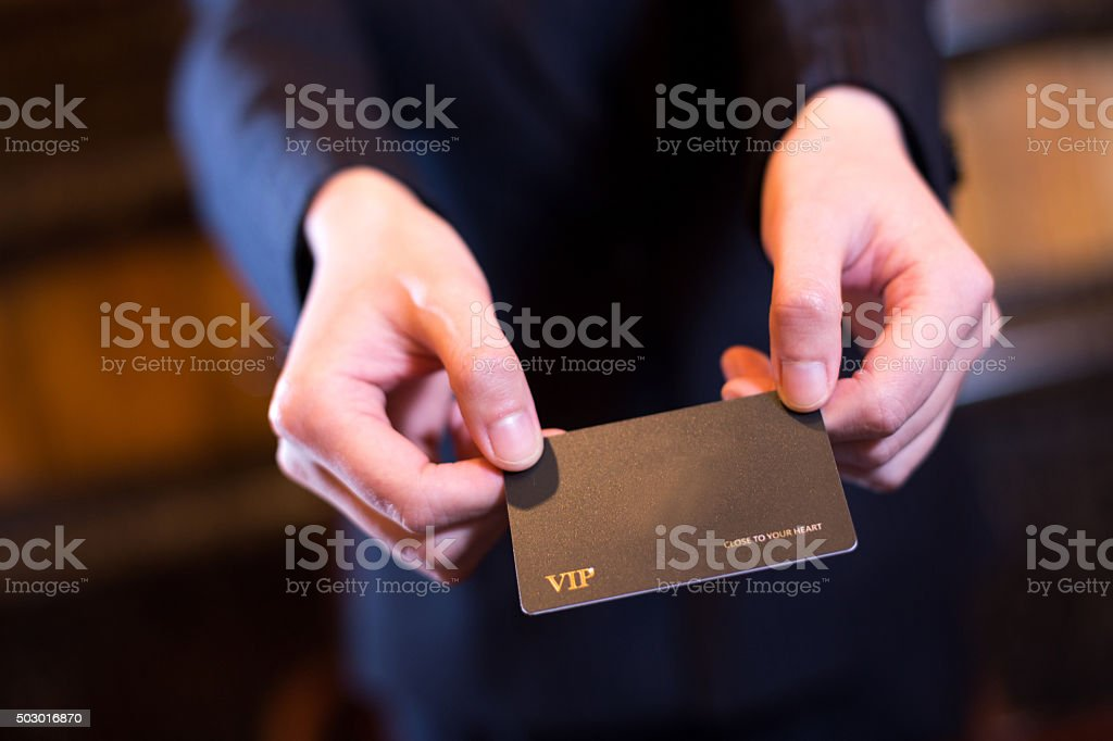 people passing card in reception room stock photo