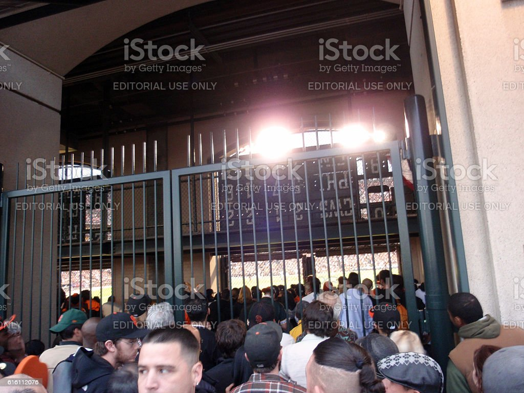 People peek into Ballpark from behind the fence stock photo