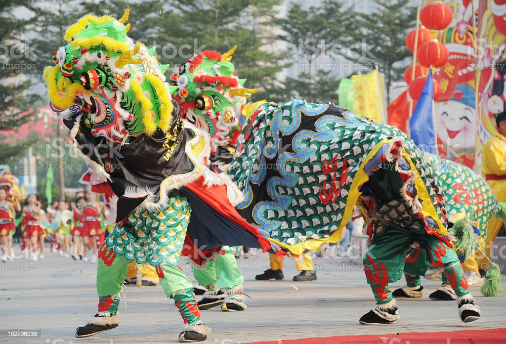 People performing Chinese dragon lion dance stock photo