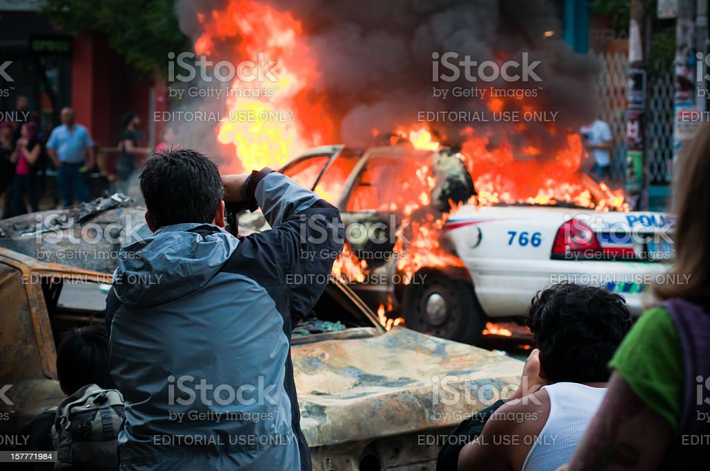 People photographing a fire stock photo