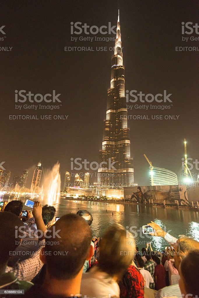 People photographing the fountain in Dubai stock photo