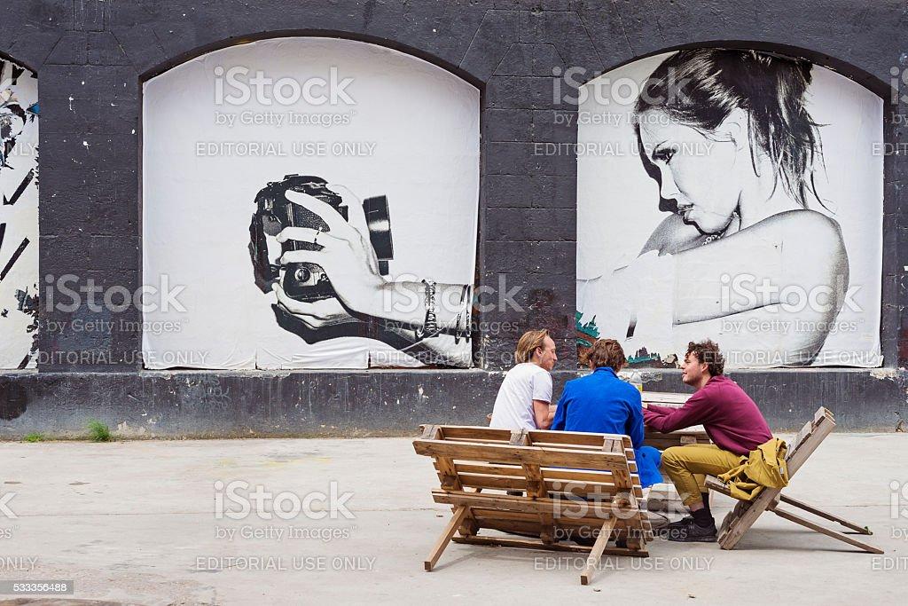 People picniking at Espace Darwin Bordeaux, France. stock photo